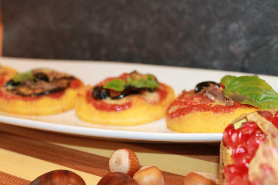 Ricetta pizzette di polenta con formaggi